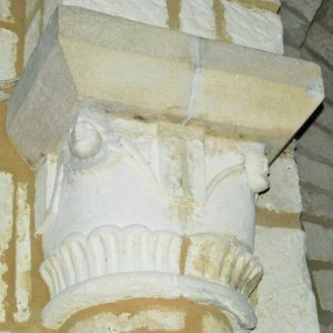 Carved capital supporting the chancel arch