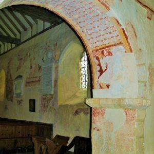 chancel arch with grimacing man painting