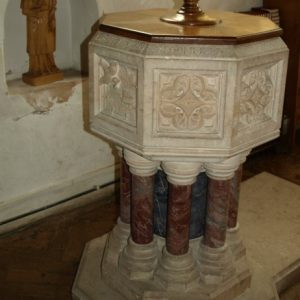 Octagonal font with marble shafted base