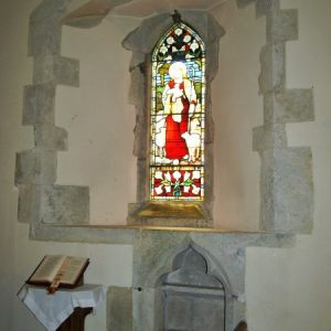 South chancel window wth 14th century piscina below