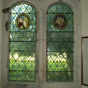 Stained glass roundels of the Nativity and St George