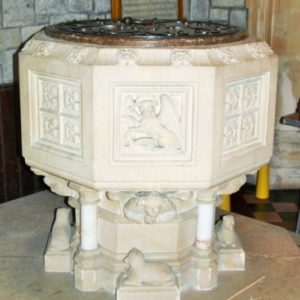The finely carved octagonal font