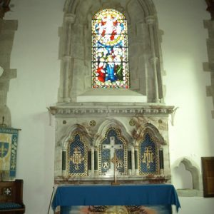 The sacristy, reredos and east window