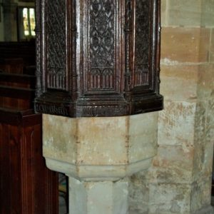Octagonal font with oak canopy