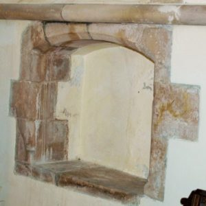 The piscina in chancel south wall