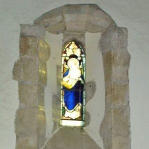 Lancet window above porch