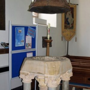 14th century font with 17th century suspended cover