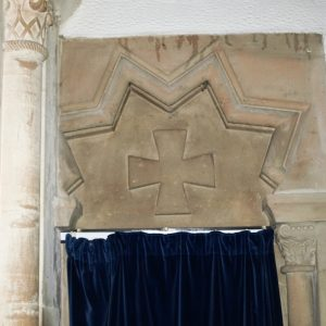 A strange star shaped head over the north aisle west doorway
