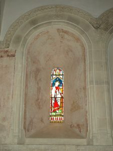 One of three lancet windows over the altar