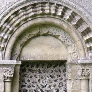 North doorway with carved semi-circular head