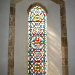 A lancet window in the chancel south wall
