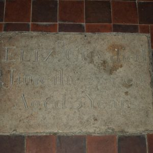 A stone plaque in the nave floor