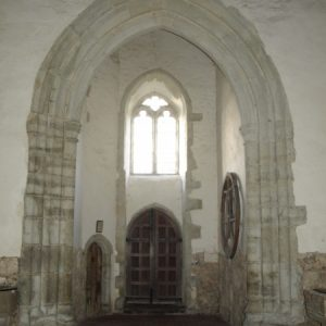 The tower arch and west window