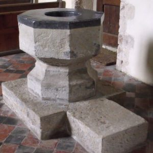 Octagonal font with lead cover