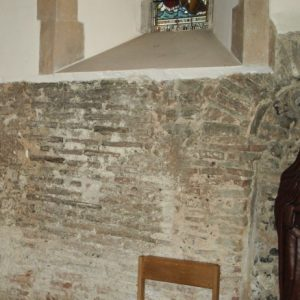The chancel wall with Roman bricks