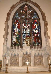 The reredos and east window