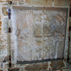 Coffin slab mounted on tower wall