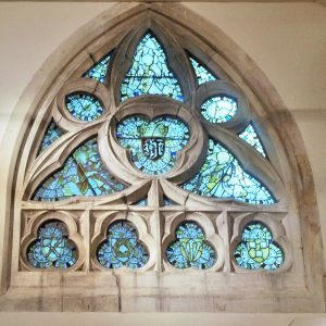 Window with crucifixion objects in trefoils