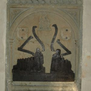 Brass on the north chancel wall