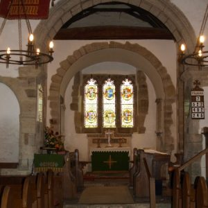 The chancel arch and east window
