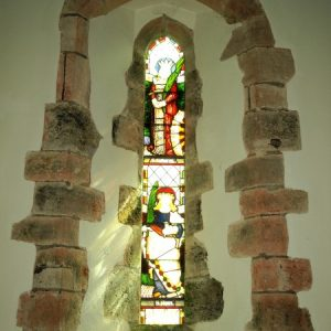 Stained glass lancet in chancel