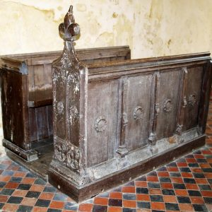 Carved pew in chancel