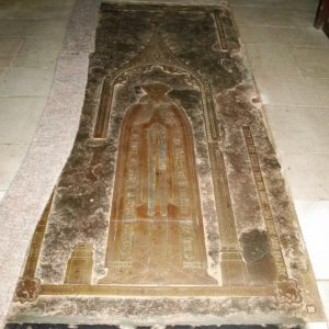 Brass tomb cover in chancel floor