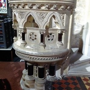 Stone pulpit with black marble columnettes