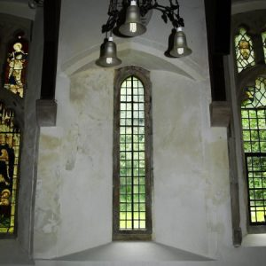 Lancet window between nave buttresses