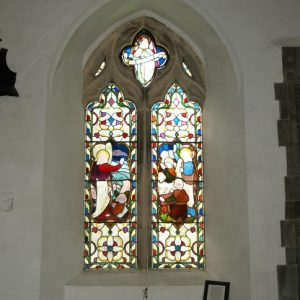 2-light stained glass window in north wall of chancel