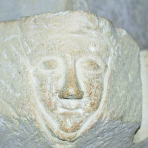 carved face on chancel arch impost