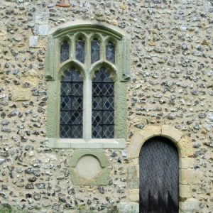 South chancel wall with blocked round low-side window and priest's door