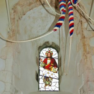 A deeply splayed window in the tower