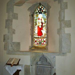 South chancel window wth 14th century piscina below