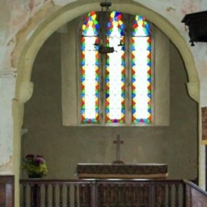 The chancel arch with east window beyond