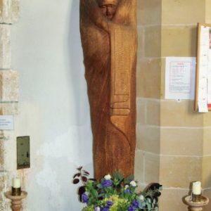 A modern wooden figure of Madonna