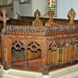 Intricate carving on the choir pews