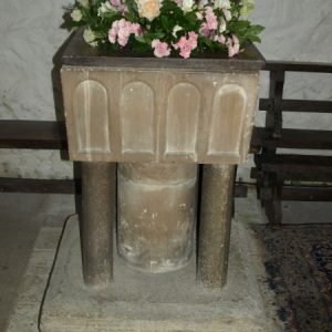 19th century font on an ancient plynth