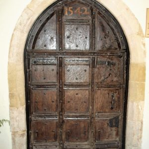 The main entrance door with 1542 date