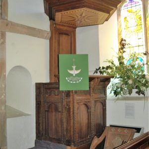 The pulpit made from Jacobean pews
