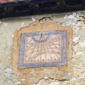 The sundial high on the south wall