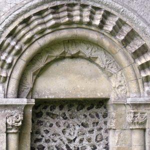 North doorway with carved semi-circular head