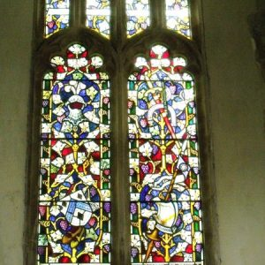19th century window with stained glass depicting knights
