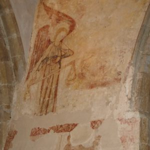 A mural depicting St Michael weighing souls