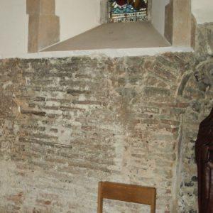 The chancel wall with Roman bricks