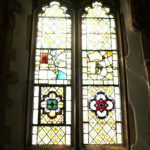 A two lancet window with 15th century glass