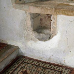 13th century piscina in the chancel