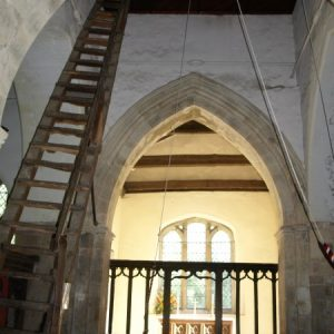 The chancel arch, 15th century screen, and ladder