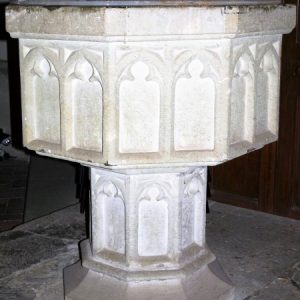 Octagonal font with trefoil arcading