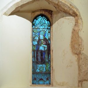 A lancet window in the west wall